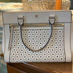 kate spade handbag with shoulder strap.